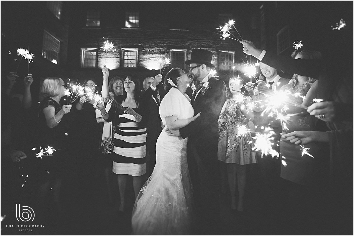 the bride and groom with the sparklers in the evening