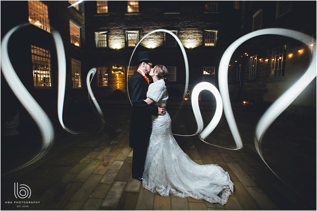 light painting with the bride and groom at night