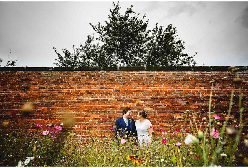 the husband and wife in the walled gardens. a beautiful place in derbyshire for a wedding. such an amazing venue
