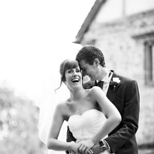 a black and white photo of a couple laughing