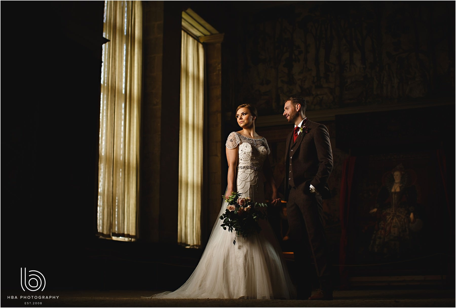 The bride and groom stood together in a dark room