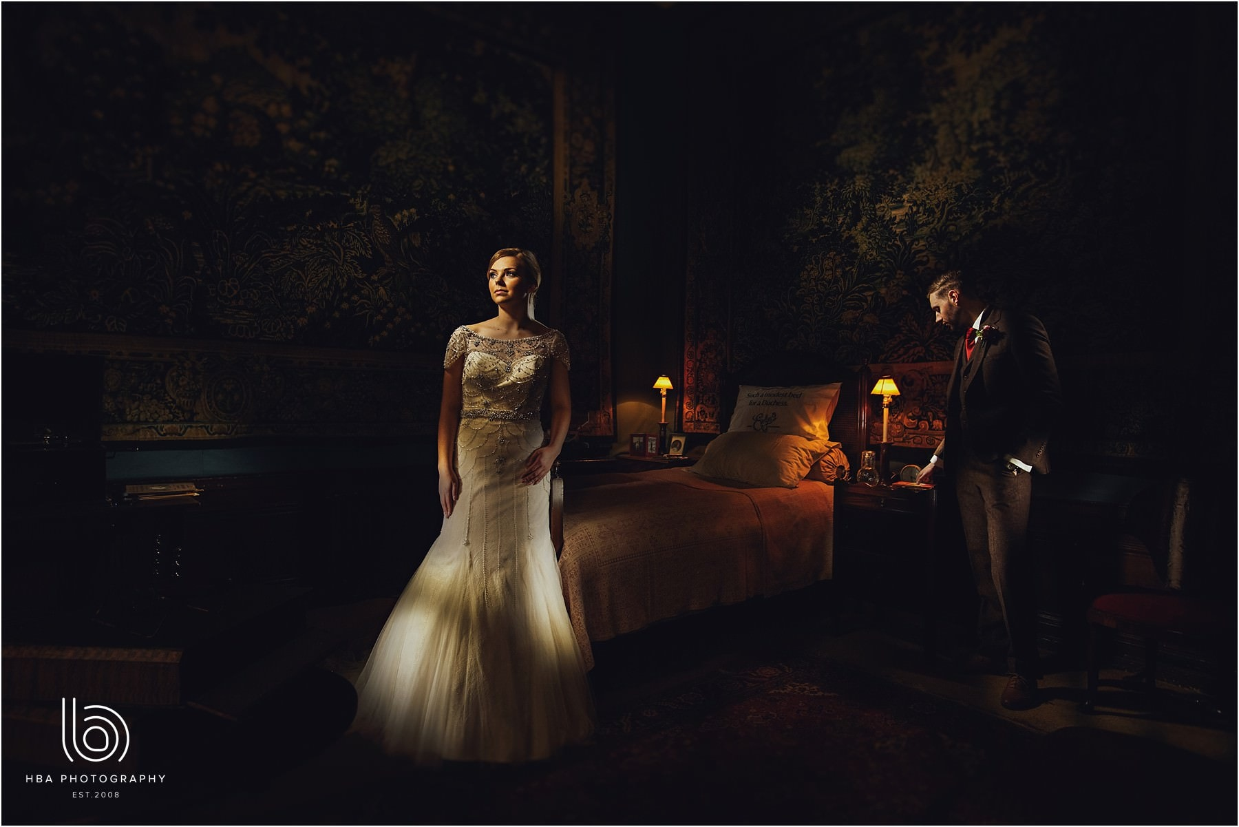 a styled shot of the bride and groom on their wedding day in one of the bedrooms at Hardwick Hall