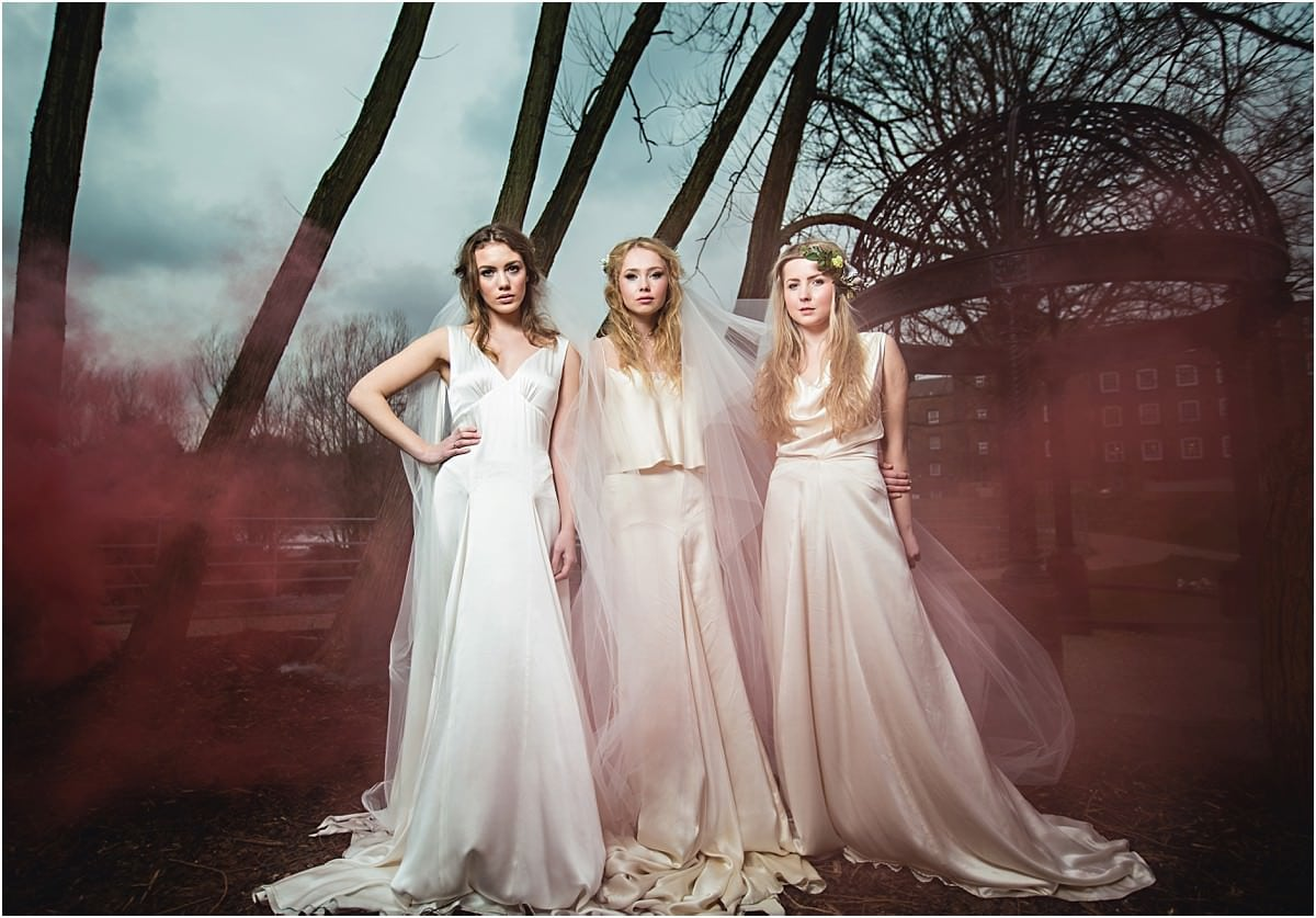 the bride and bridesmaids looking moody with red smoke