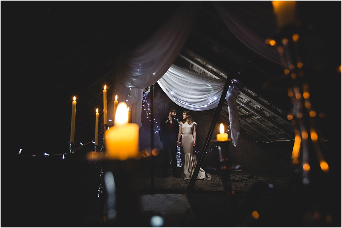 candles surround the bride and groom at the west mill