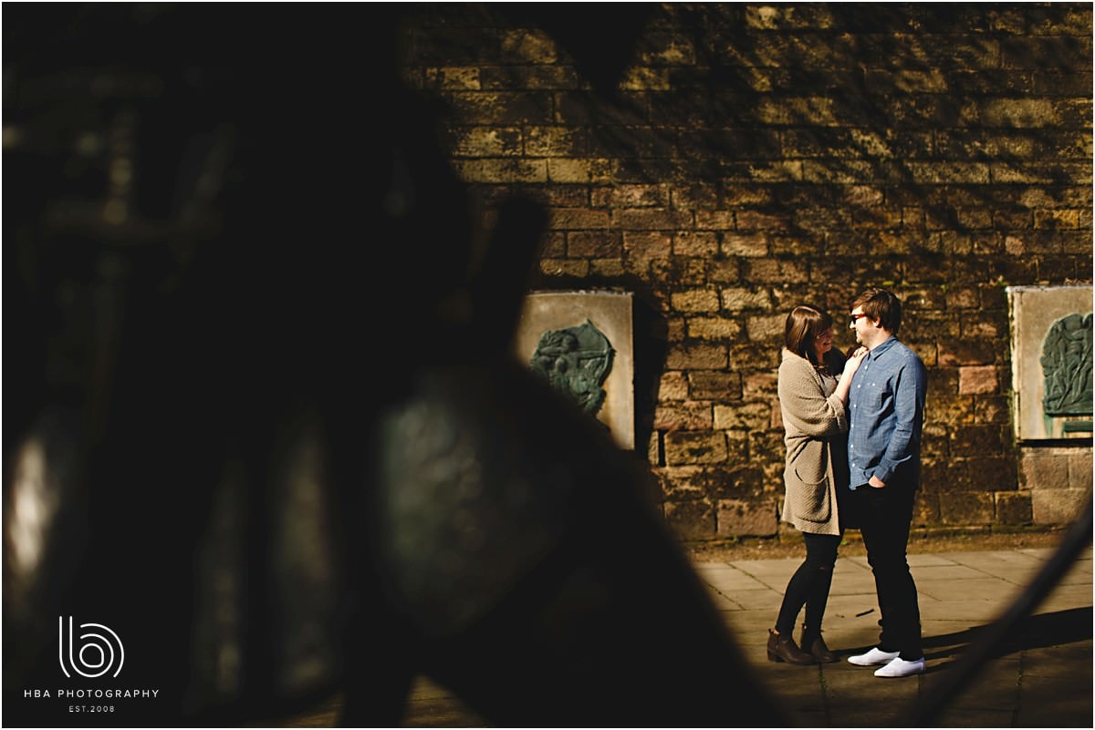 an engaged couple stood by the robin hood statue in Nottingham for their engagement