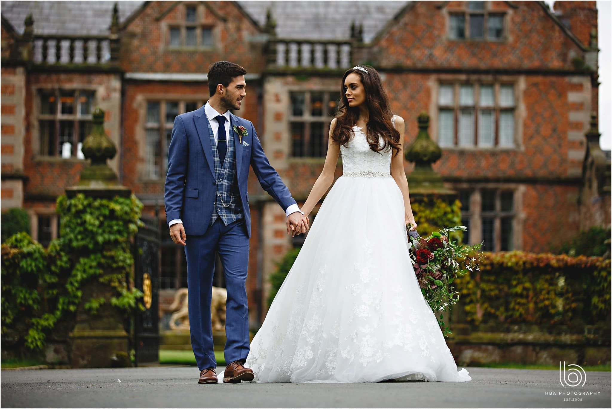 the bride and groom walking away form Dorfold Hall in Cheshire