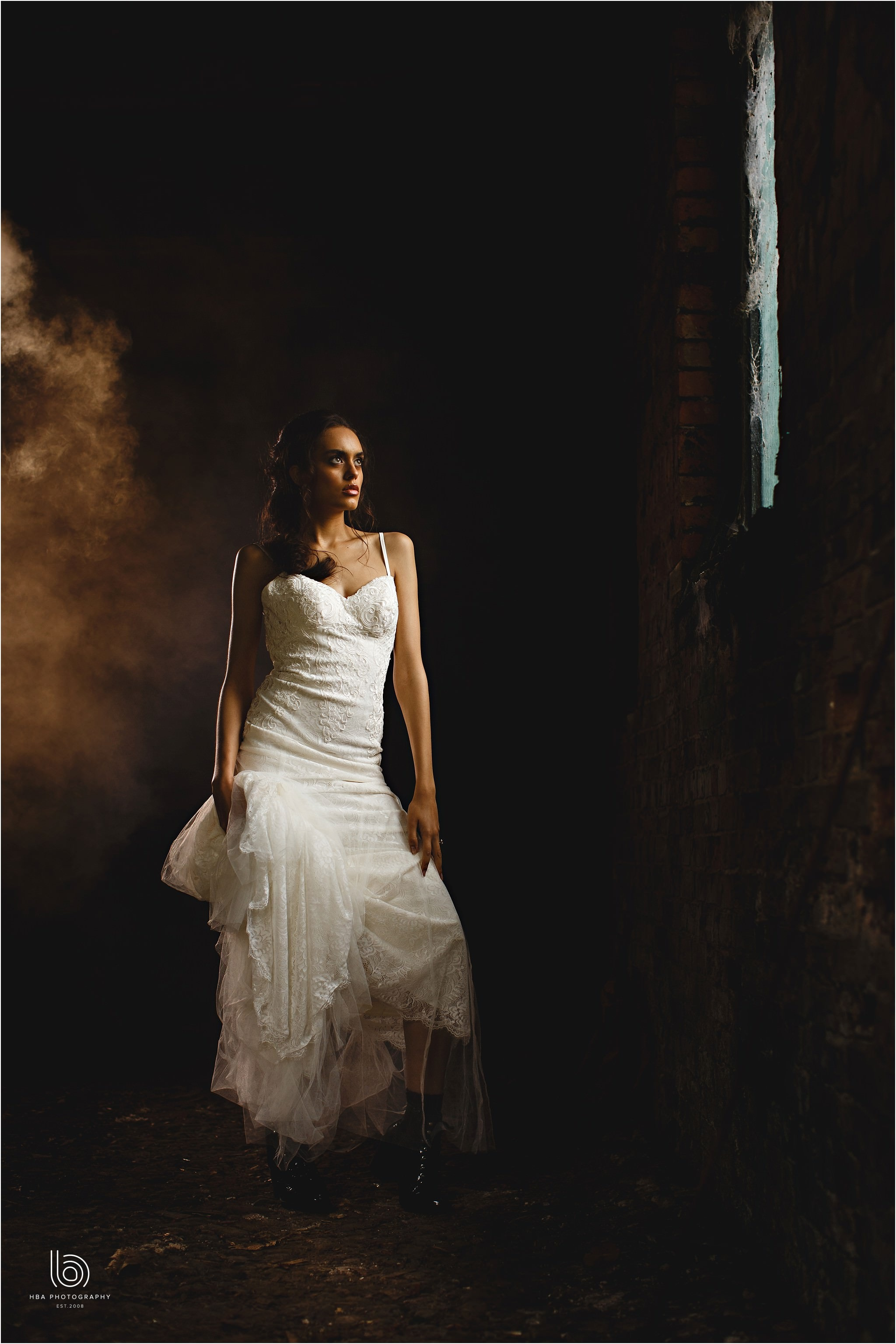 the bride stood in the old coach house