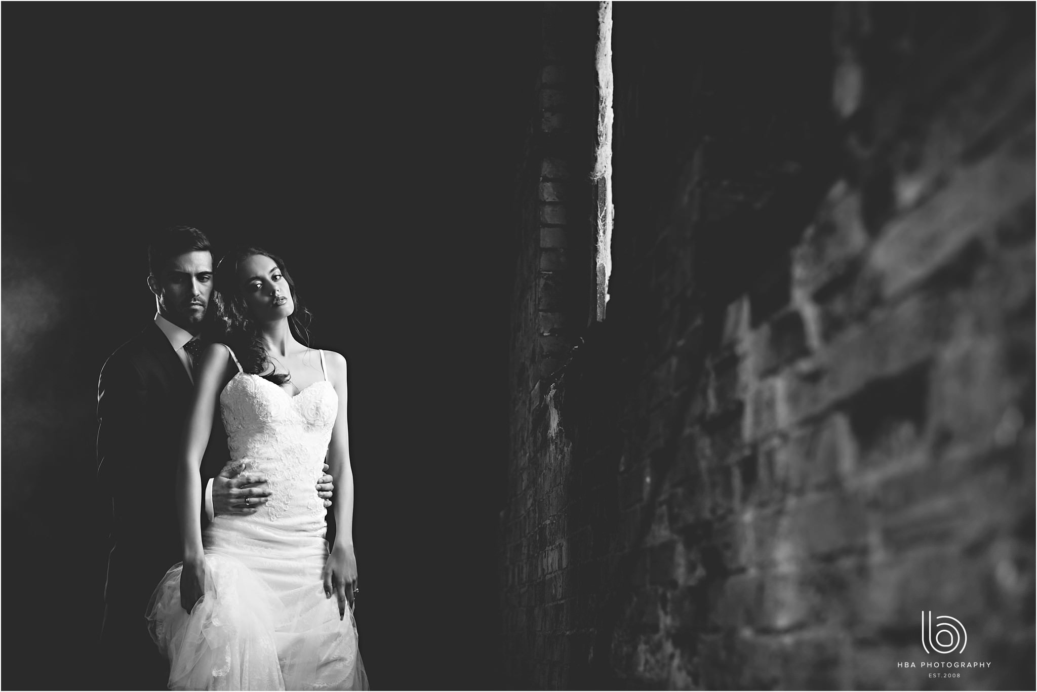 the bride and groom stood in the old coach house at Dorfold Hall