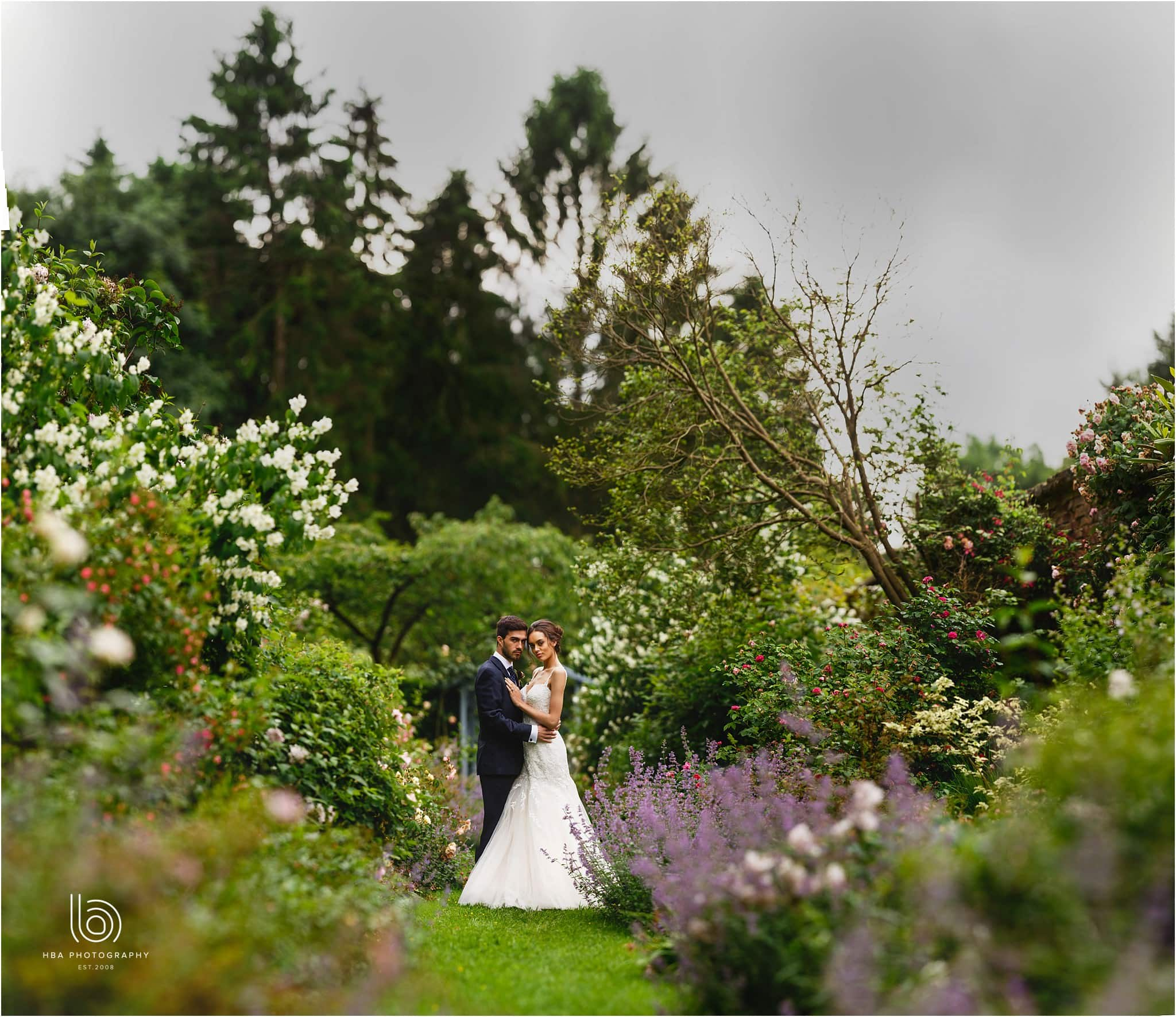 the bride and groom together surrounded by flowers