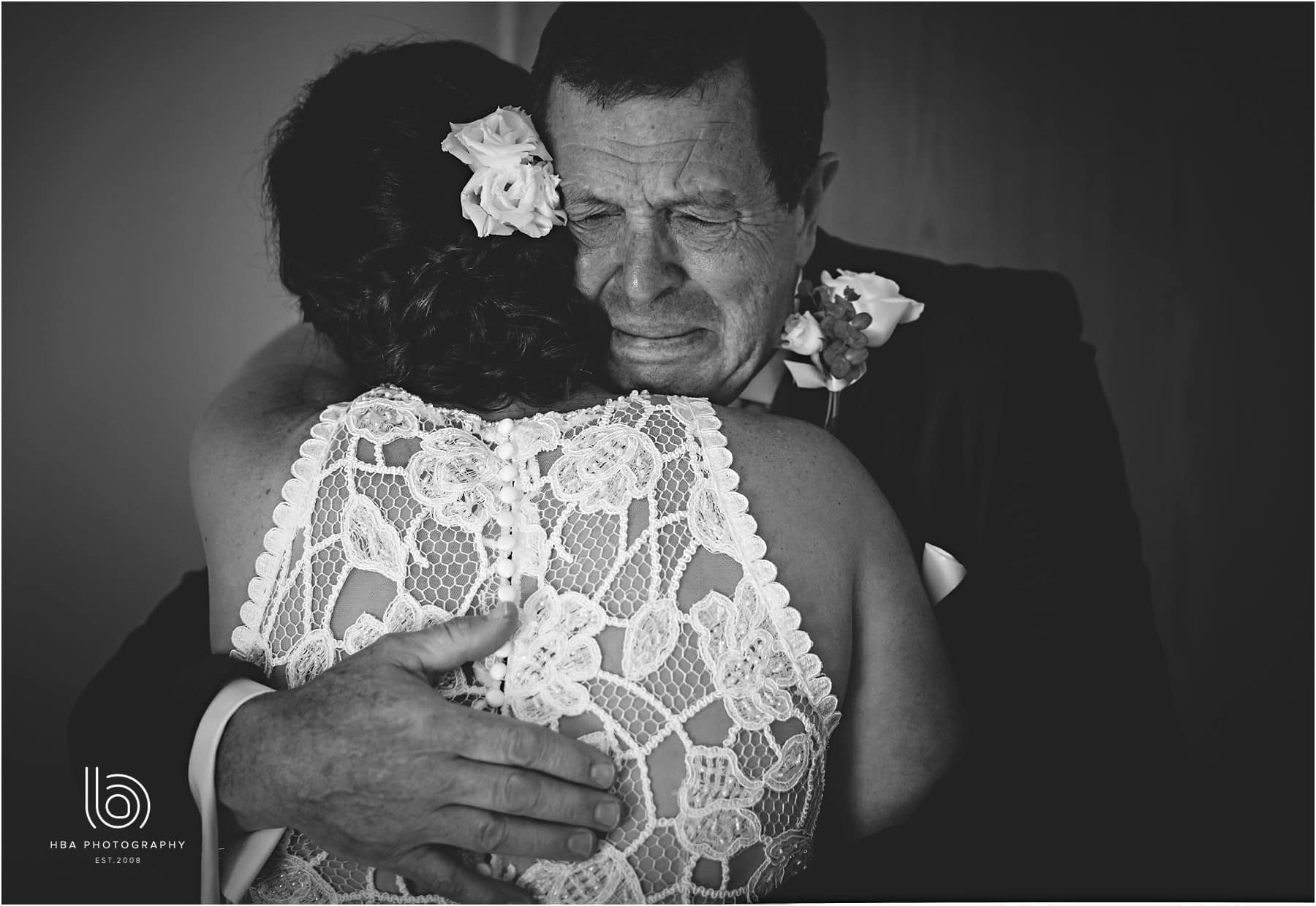 the bride's dad with tears in his eyes