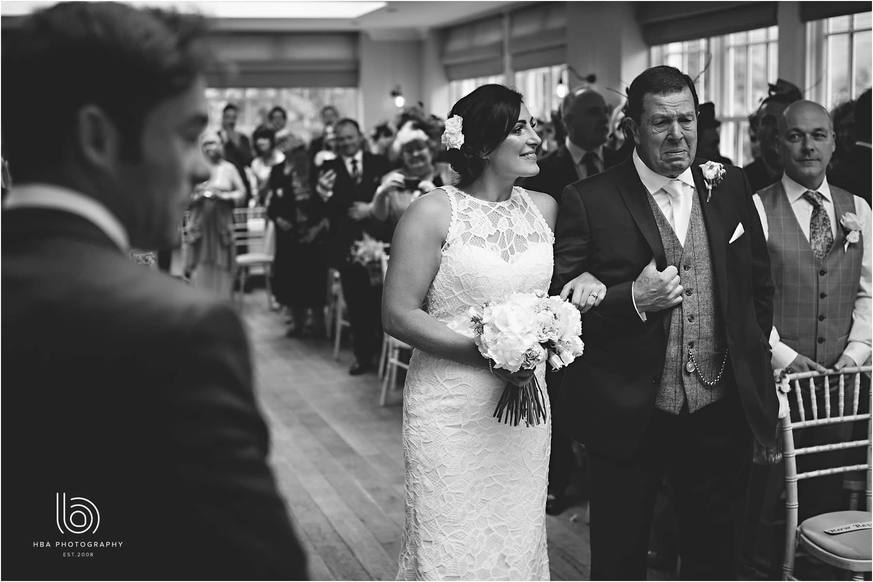 the bride walking down the aisle with her dad