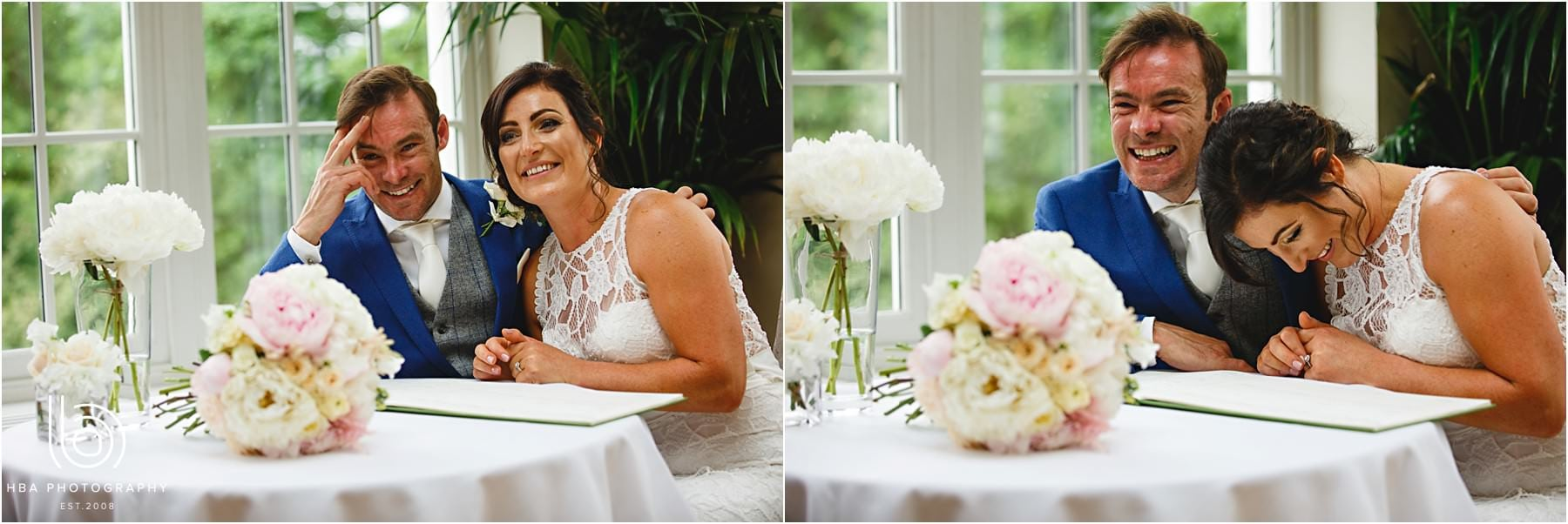 the bride and groom signing the register