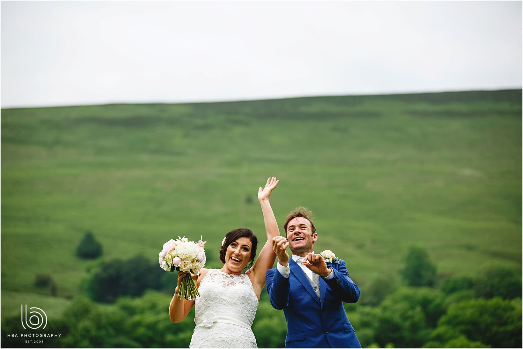the bride and groom outisde waving at their guests