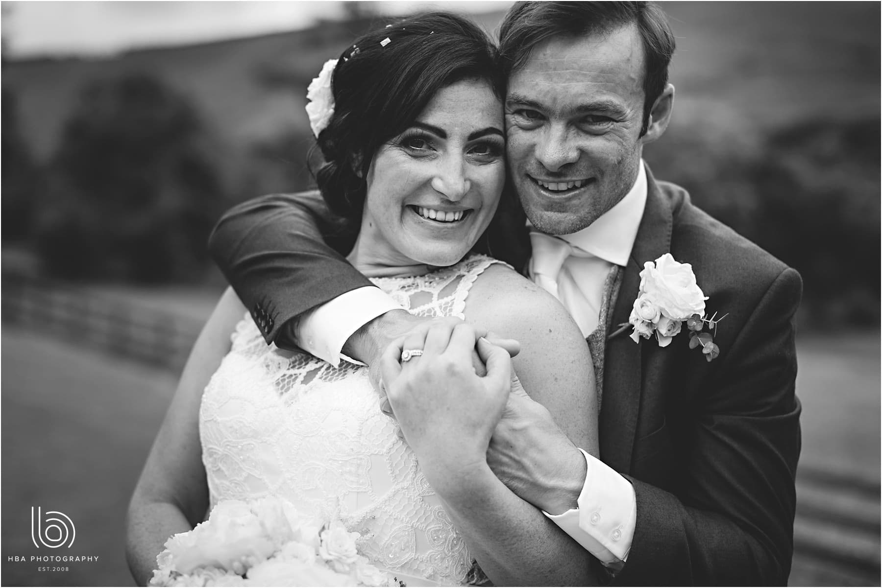 the bride and groom in black & white