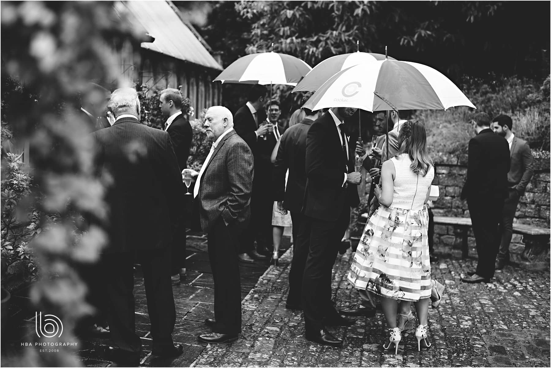guests with umbrellas