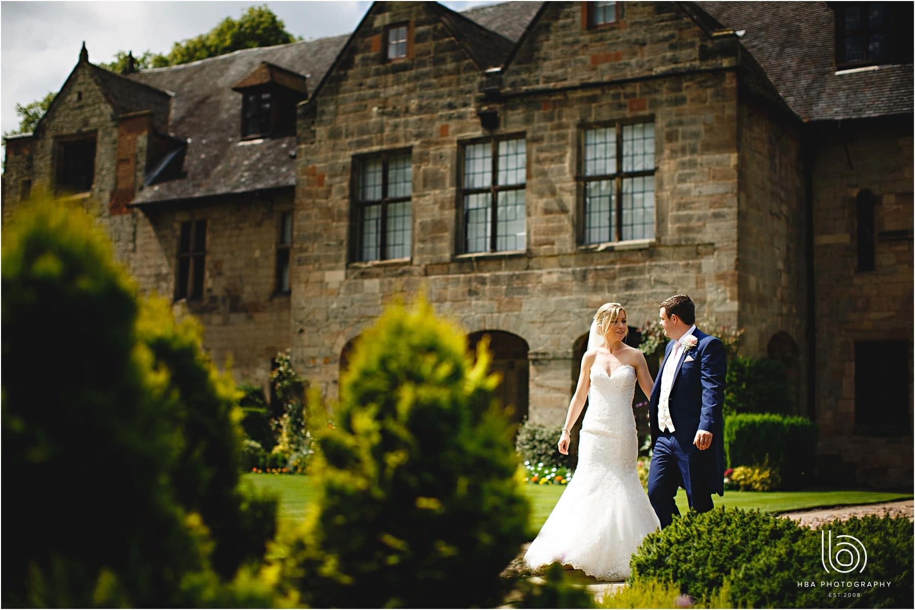 the bride & groom in the grounds of repton school
