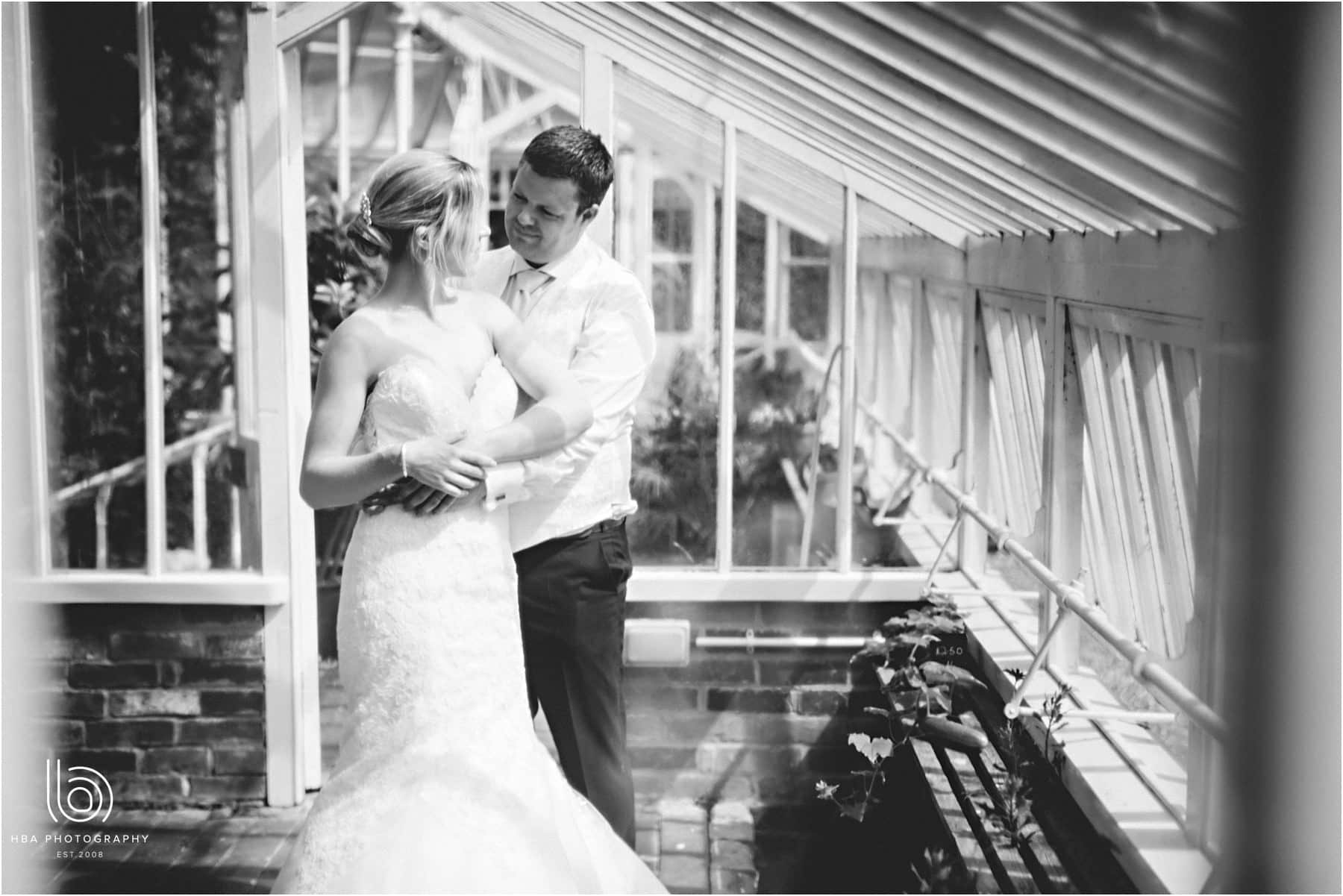 the bride & groom in the greenhouse