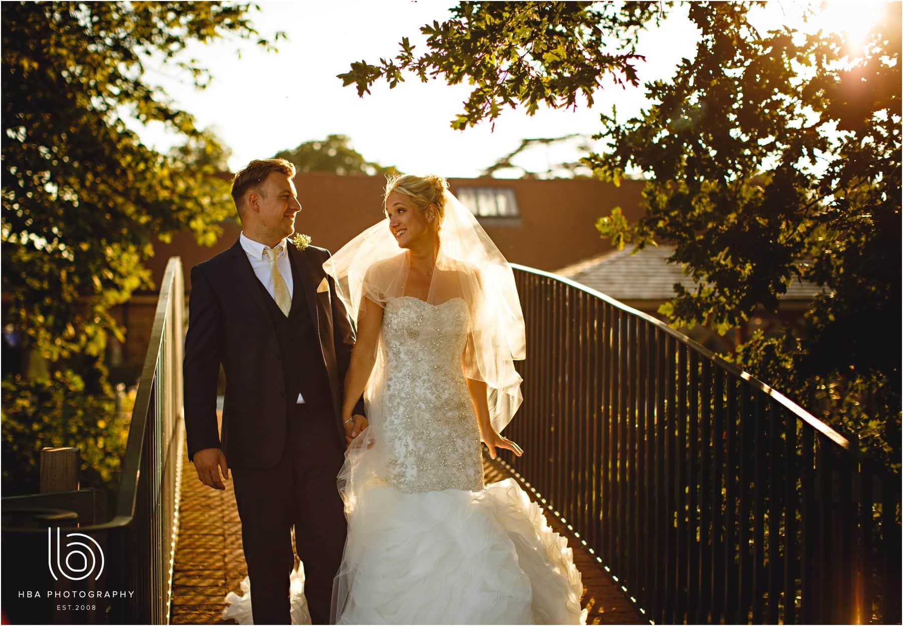 the bride & Groom walking on the bridge