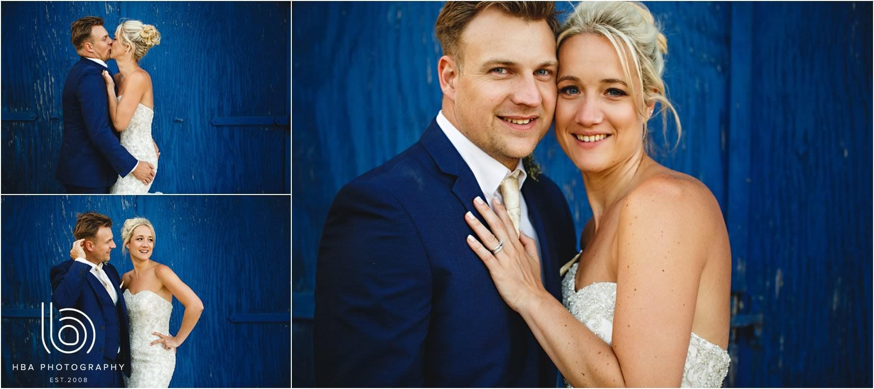 the bride & Groom infront of a big blue door