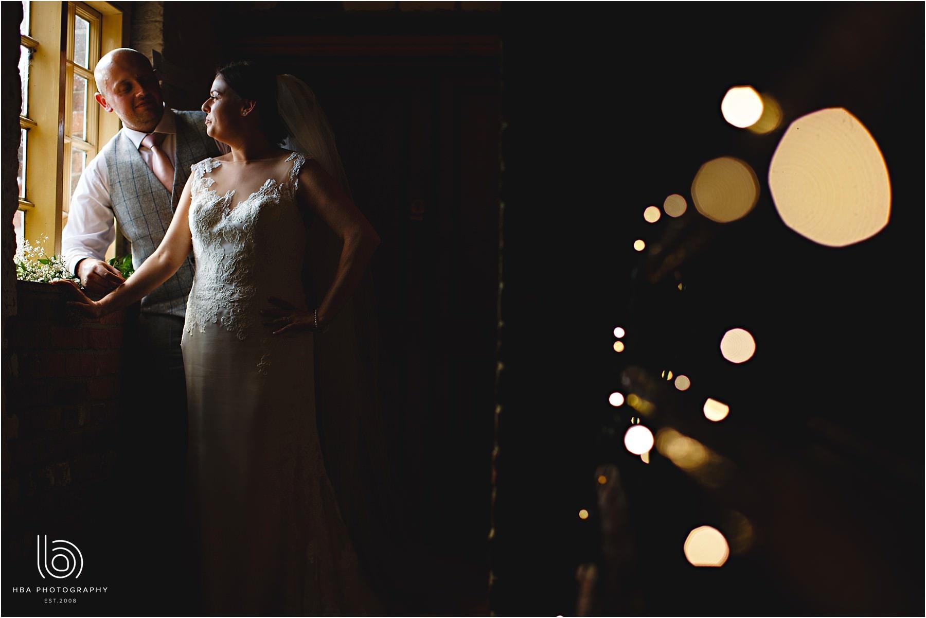 the bride & groom in twinkly lights