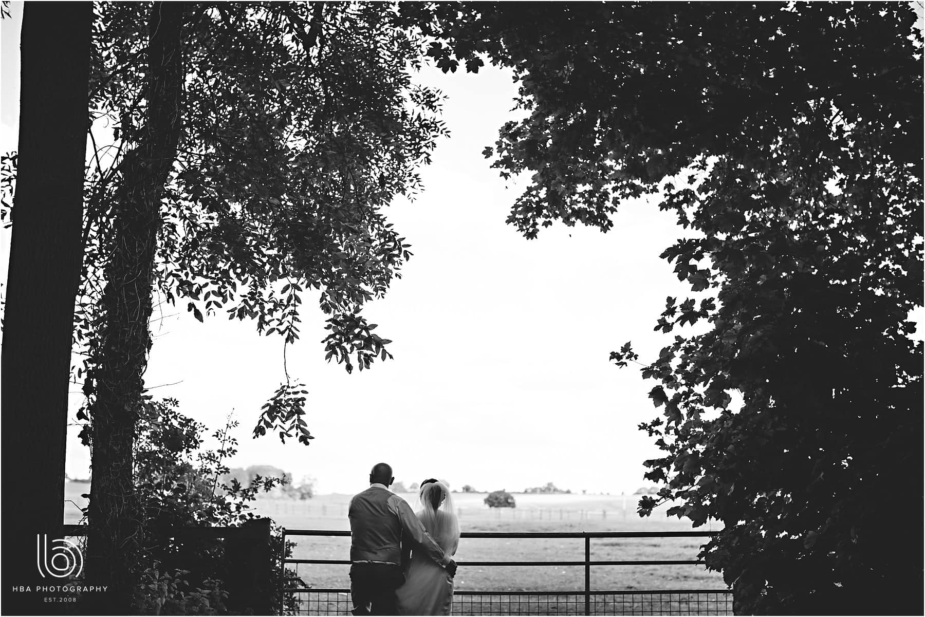 the bride & groom looking at the view