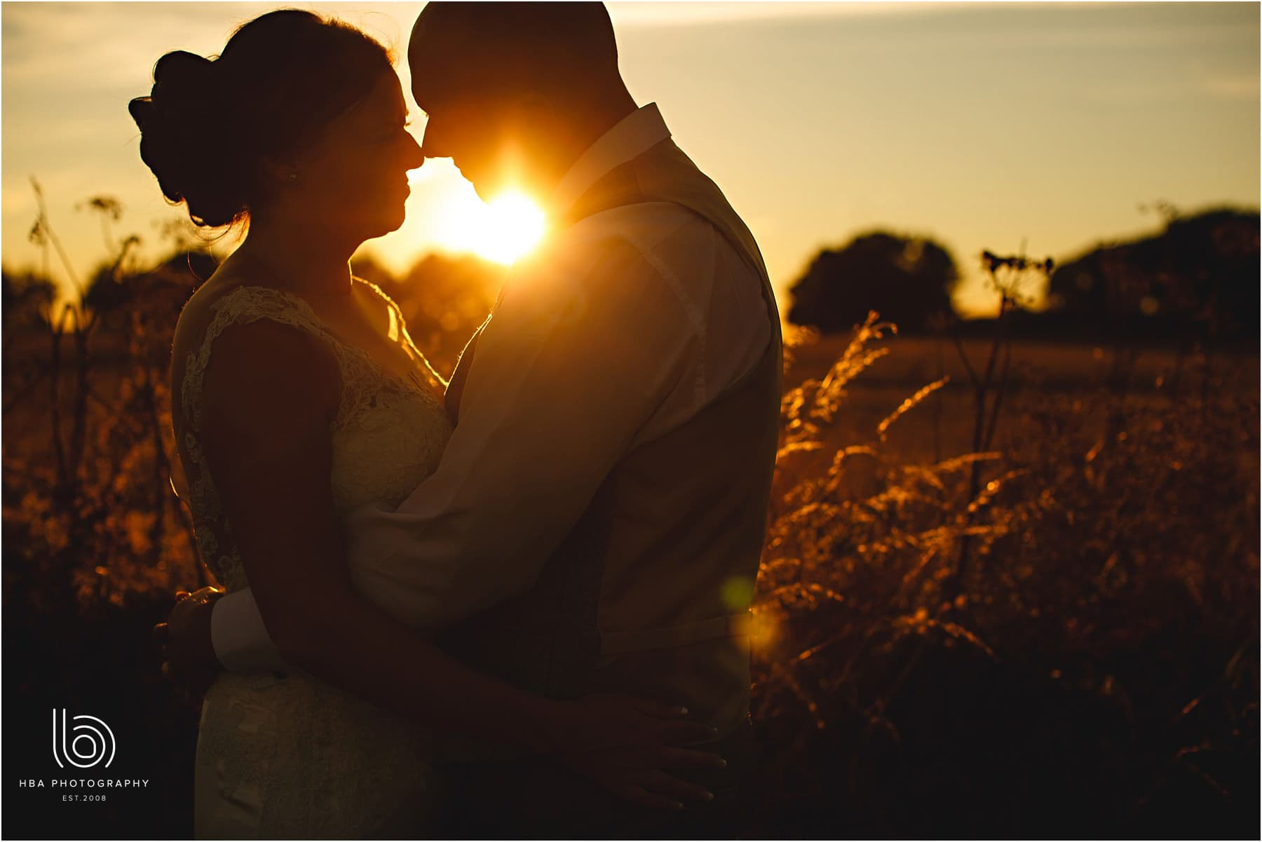 the bride & groom in a sunset