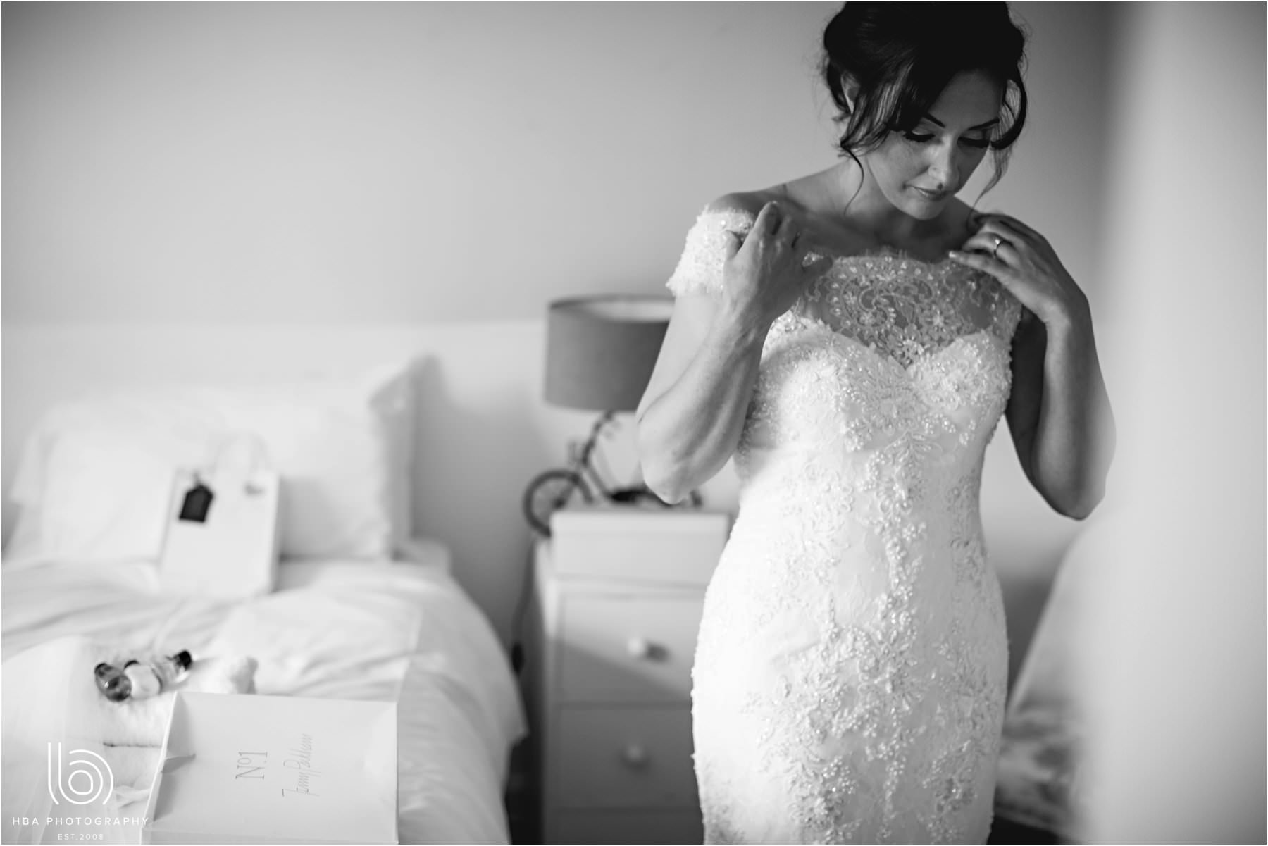 the bride putting her weding dress on