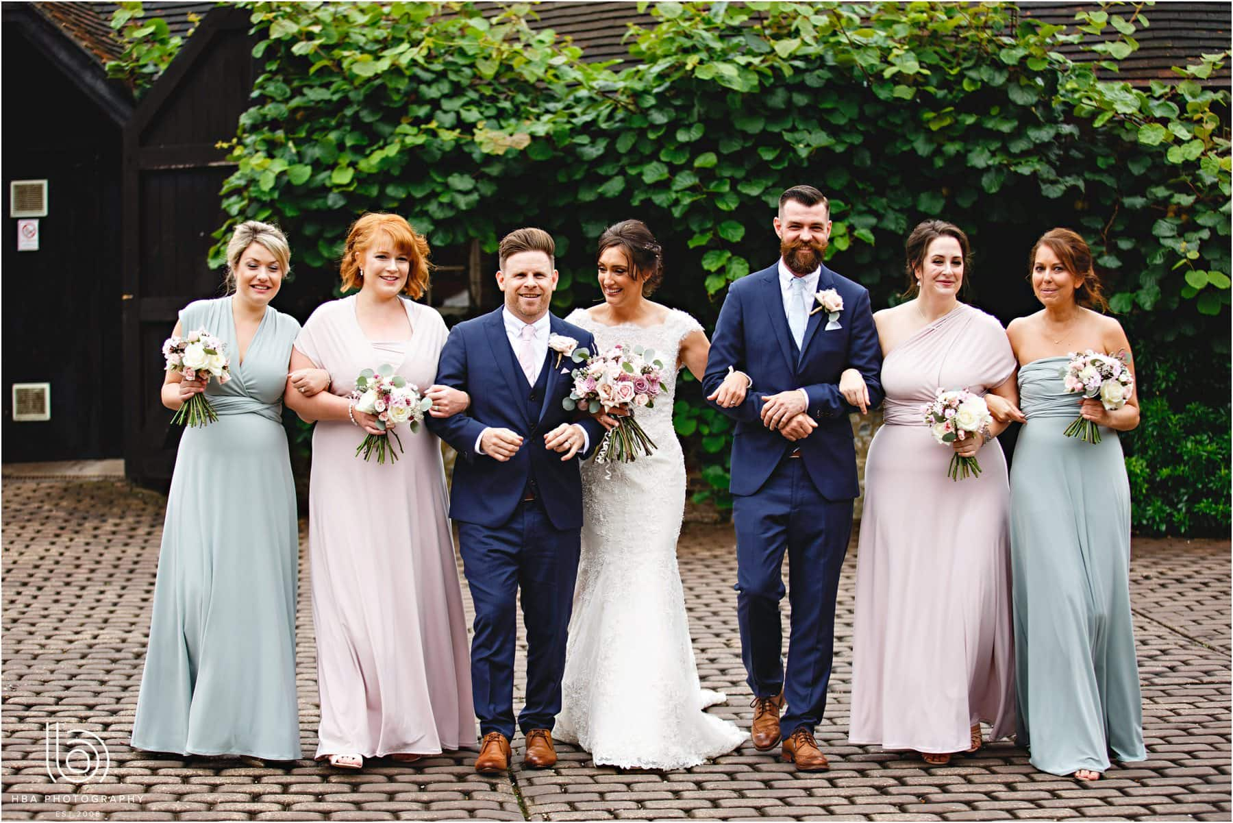 the bride and groom with the bridal party