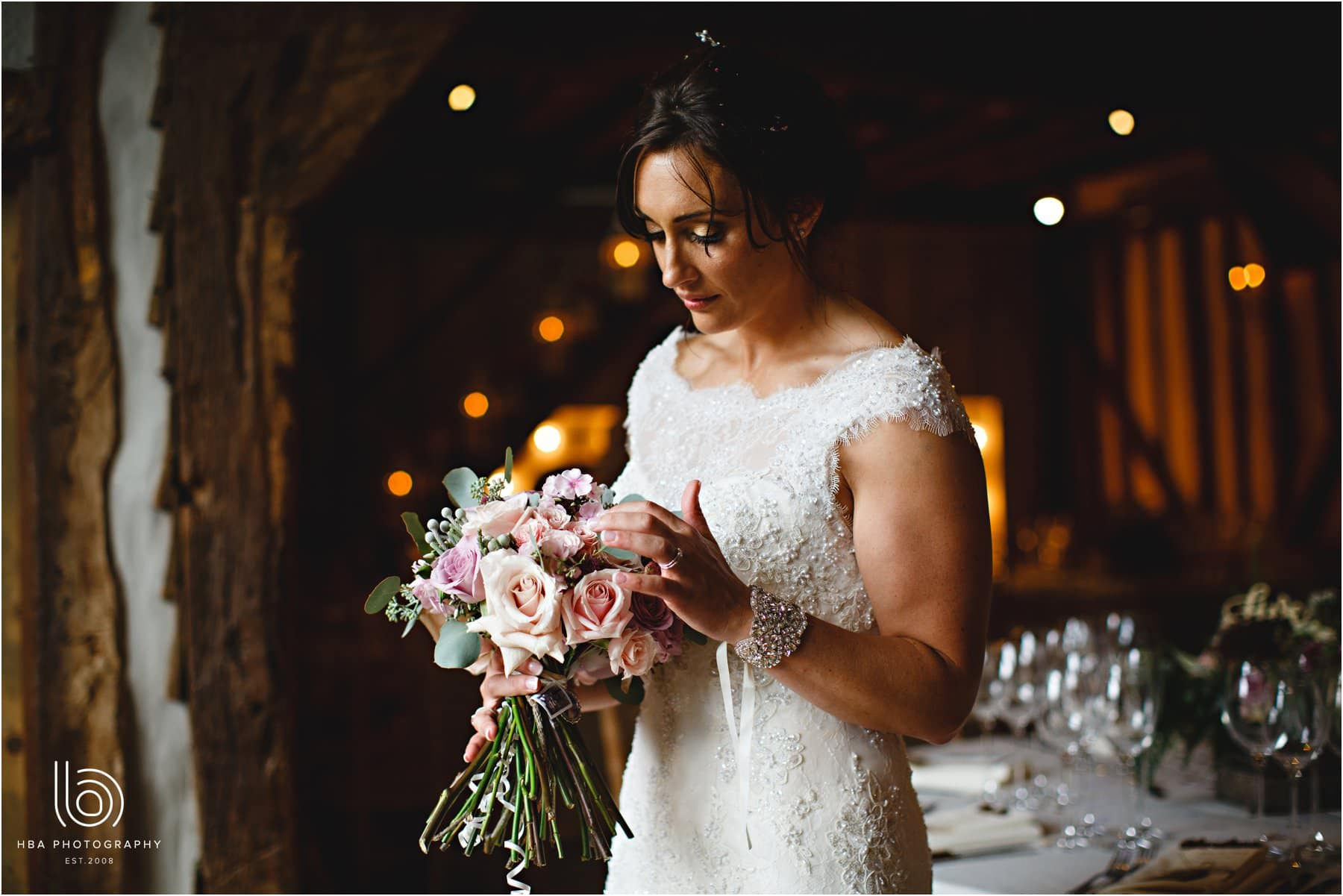 the bride looking at her wedding bouquet