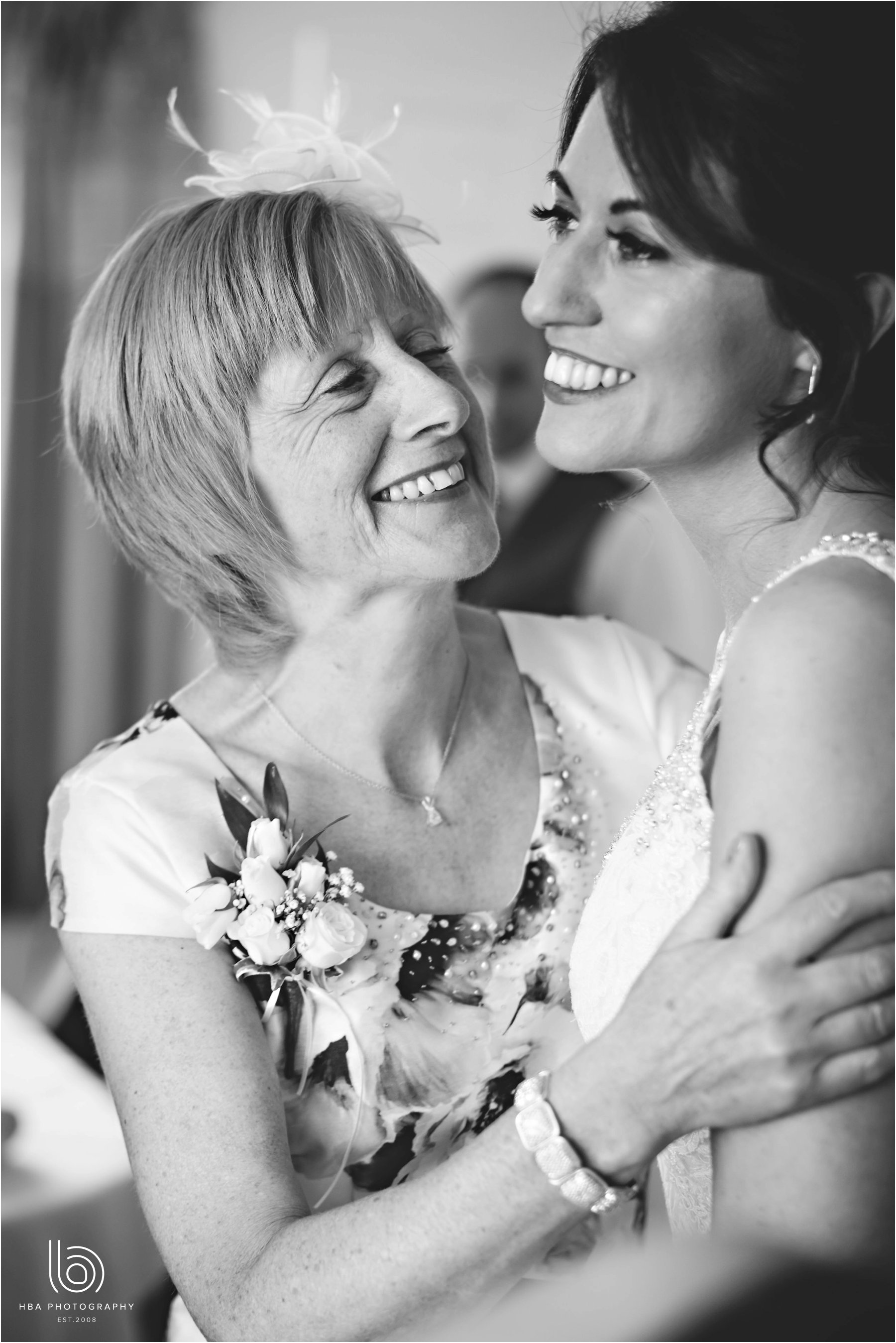 the bride and her mum laughing