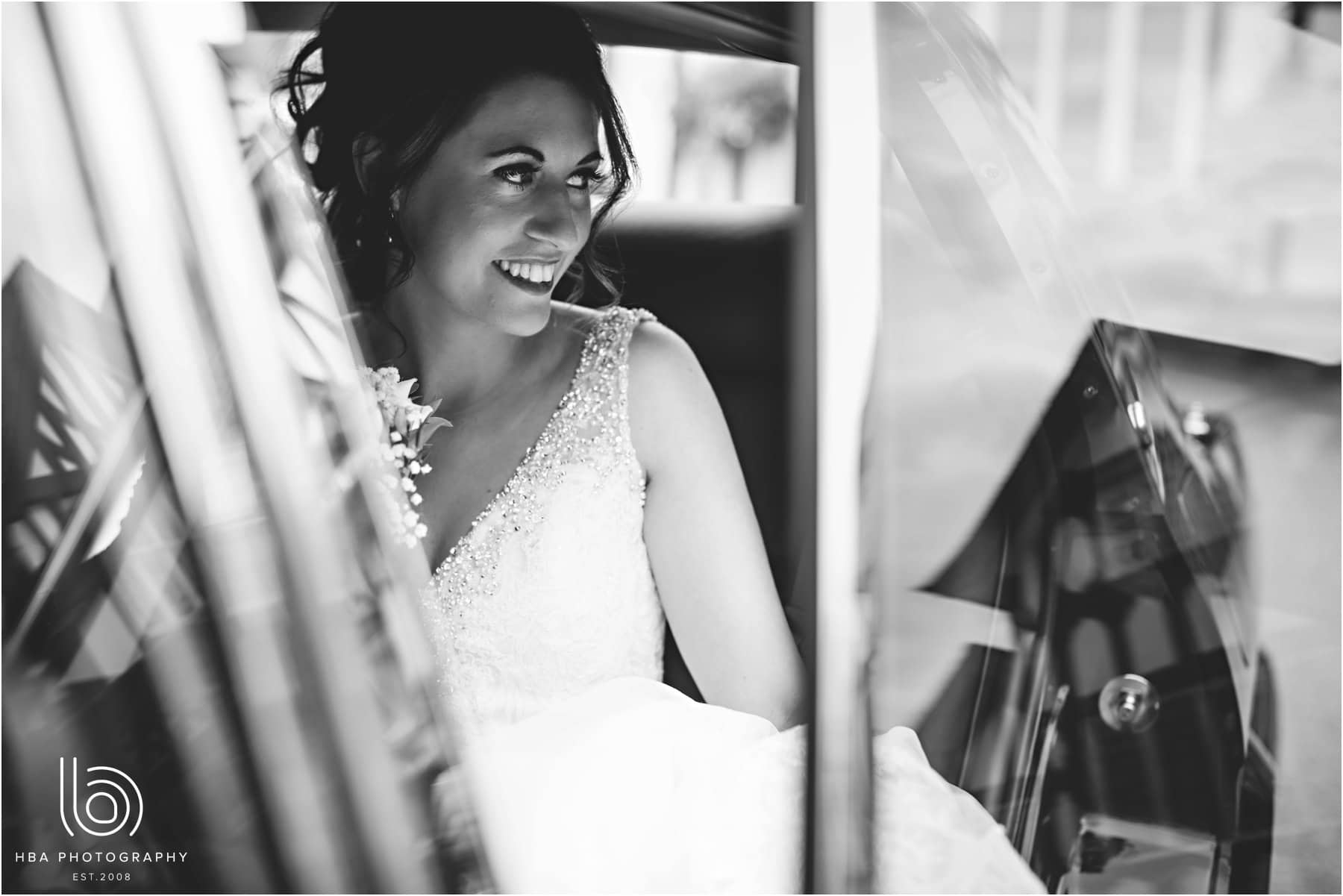 the bride in the car arriving at the venue
