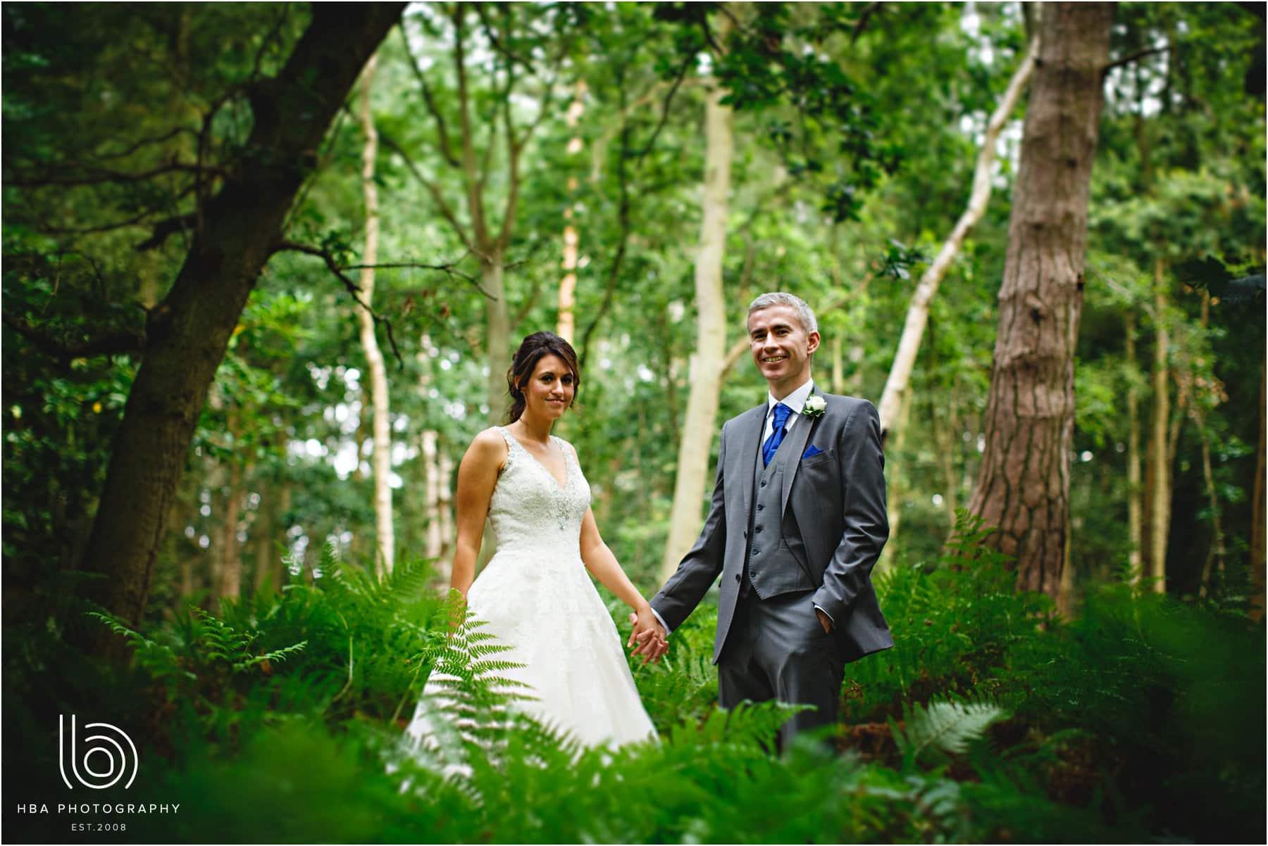 the bride & groom in the woods