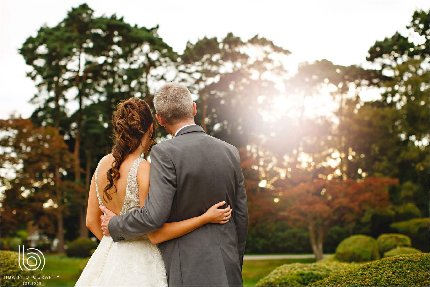 the bride & groom with a sun falre