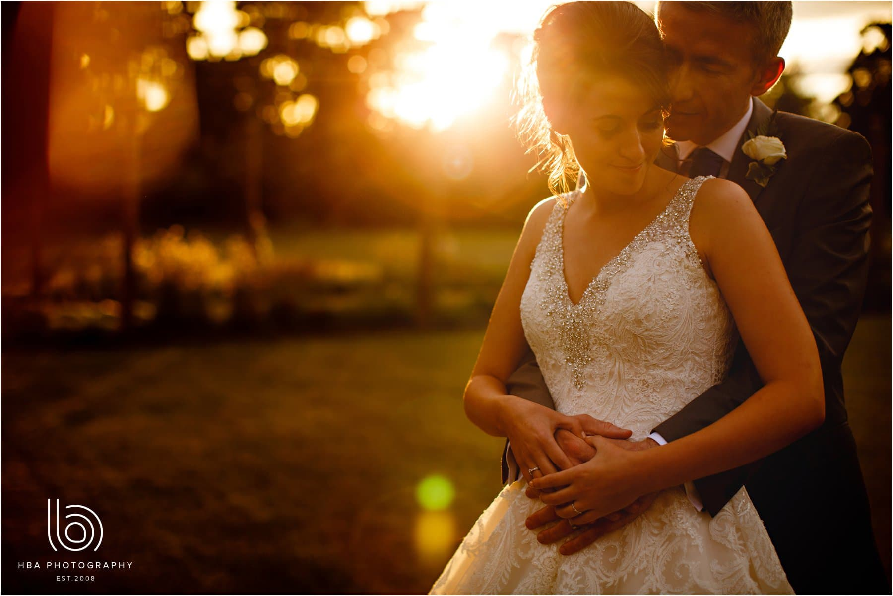 the bride & groom in the sunset