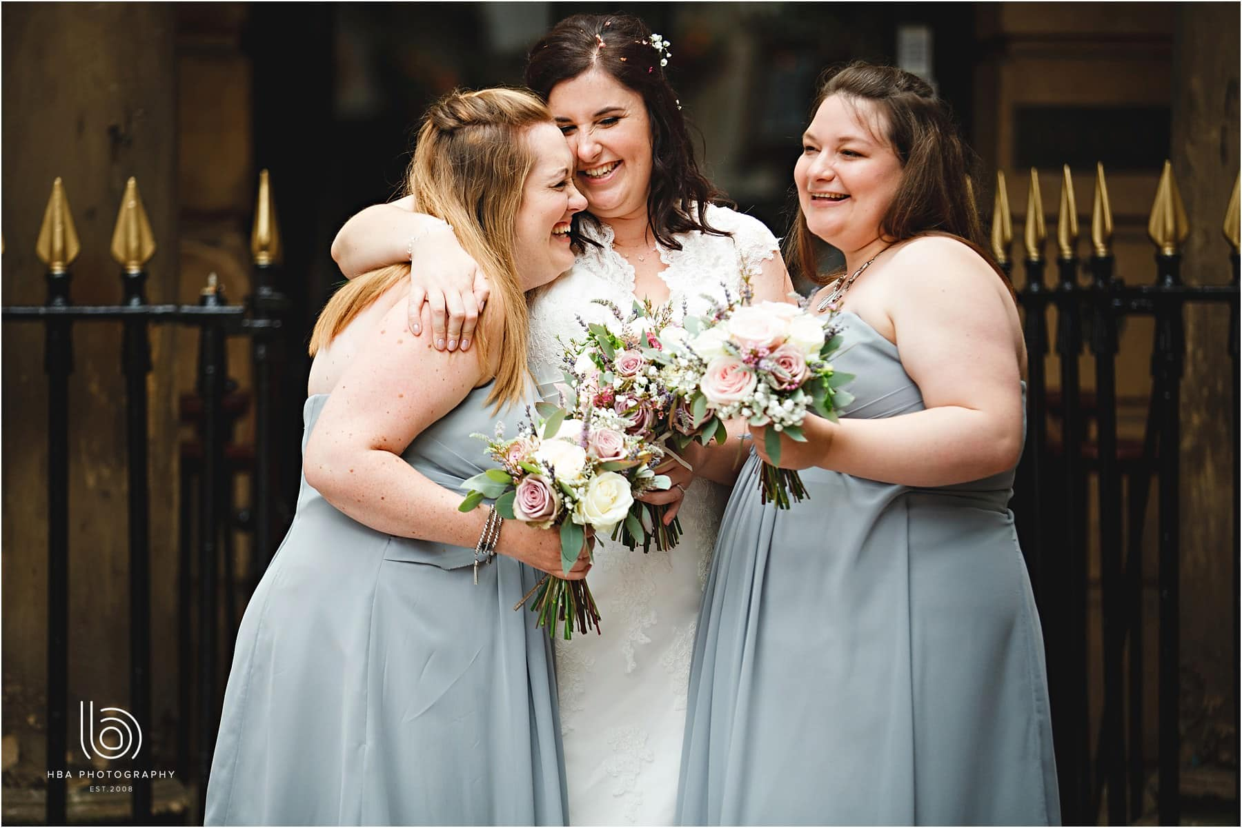 the bride and her bridesmaids together laughing
