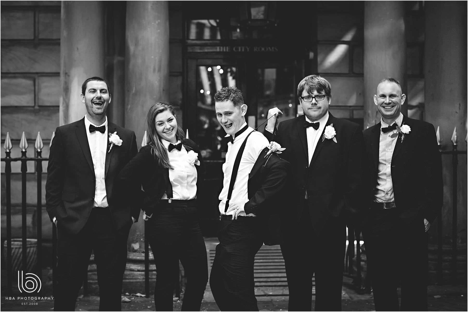 a black and white photo of the groom and his groomsmen