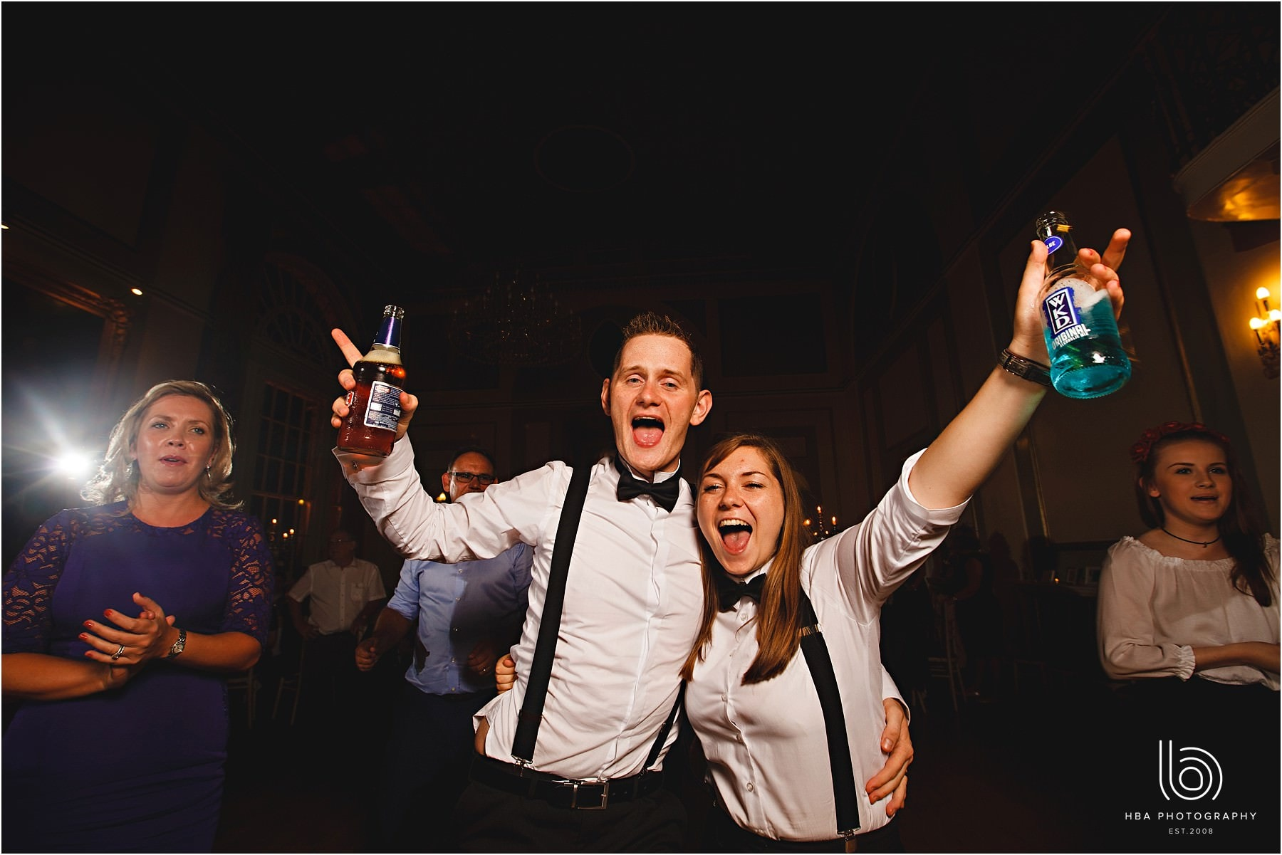 the groom and his best woman on the dance floor at the wedding
