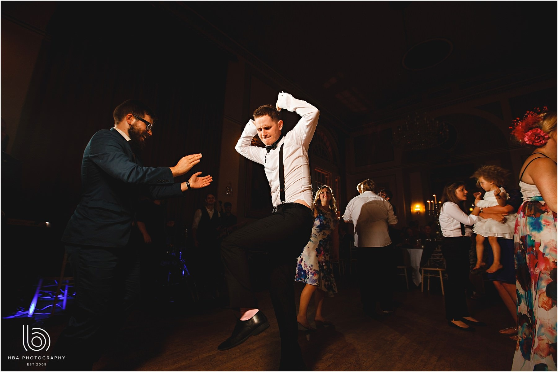 the groom dancing on their wedding day