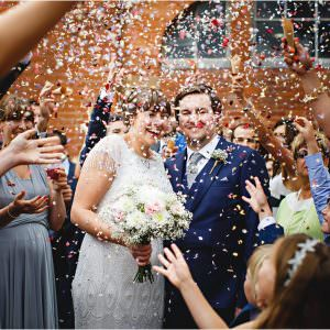 the bride & groom get covered in confetti