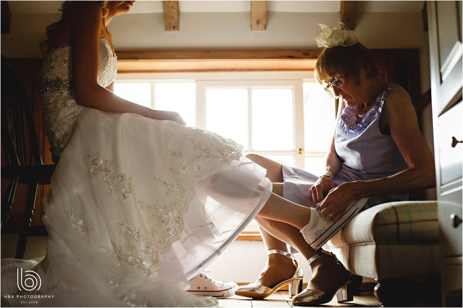 The bride's mum helping her to get dressed