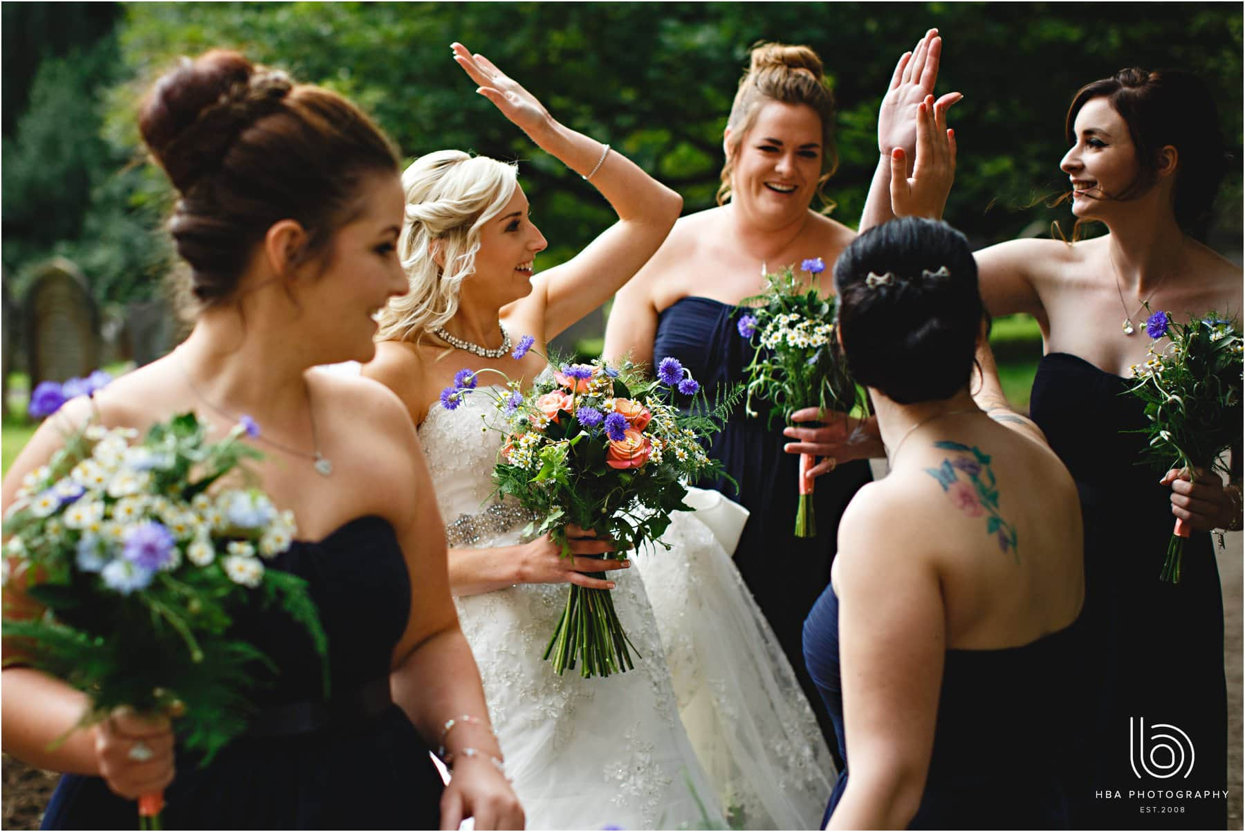 the bride & bridesmaids high fiving