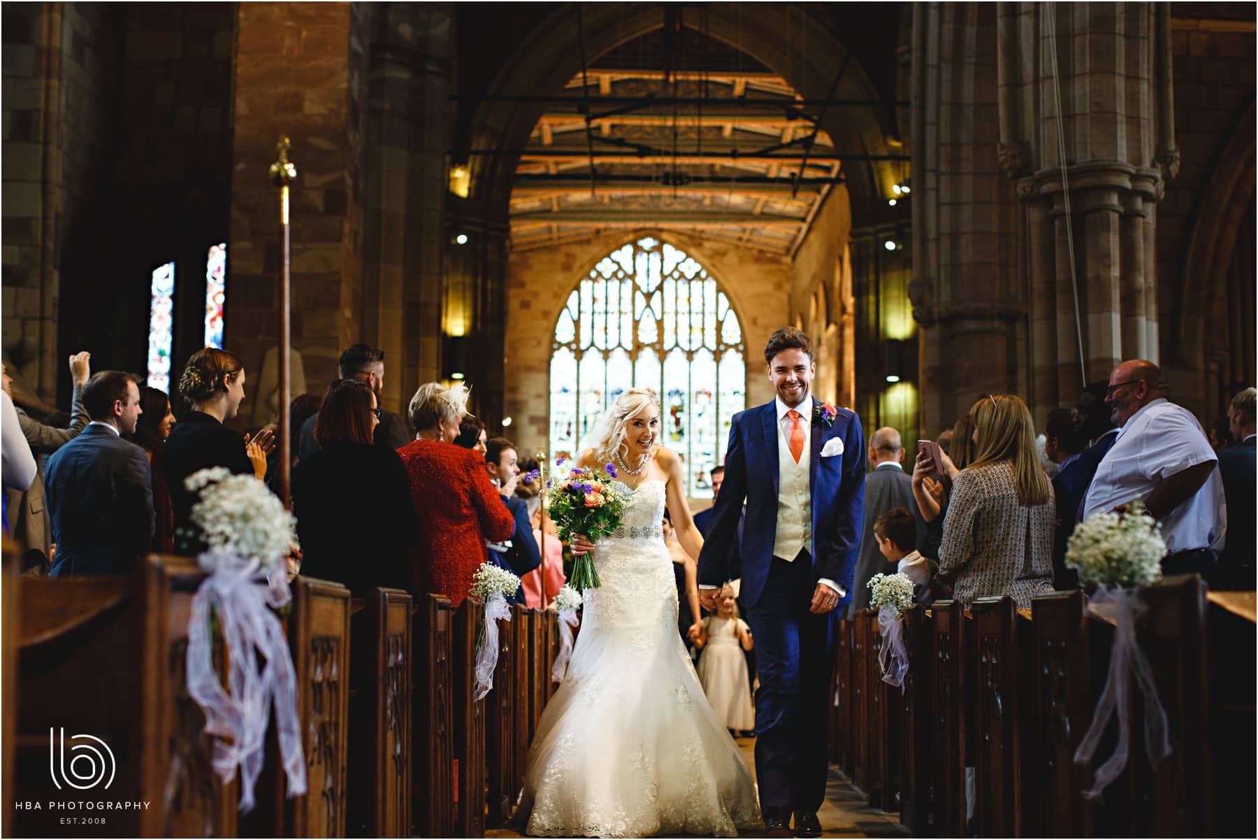 the bride and groom leaving the church