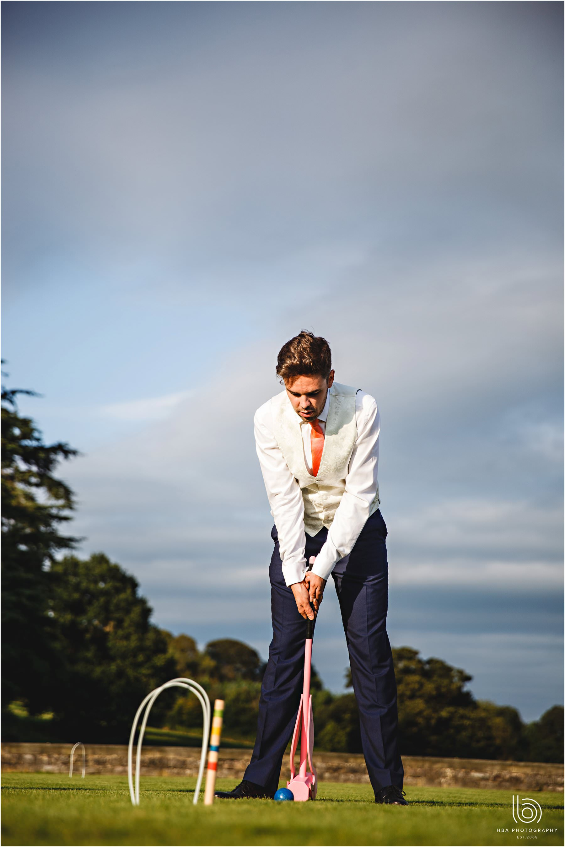 the groom playing croquet
