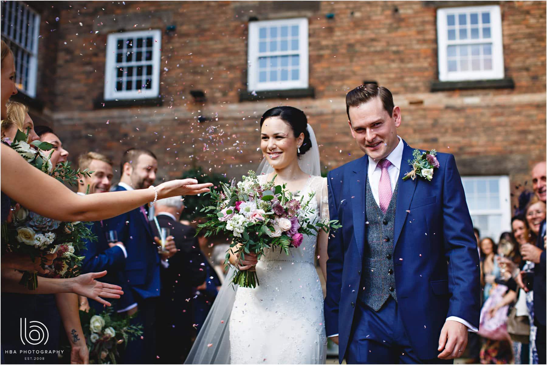 the bride & groom and confetti
