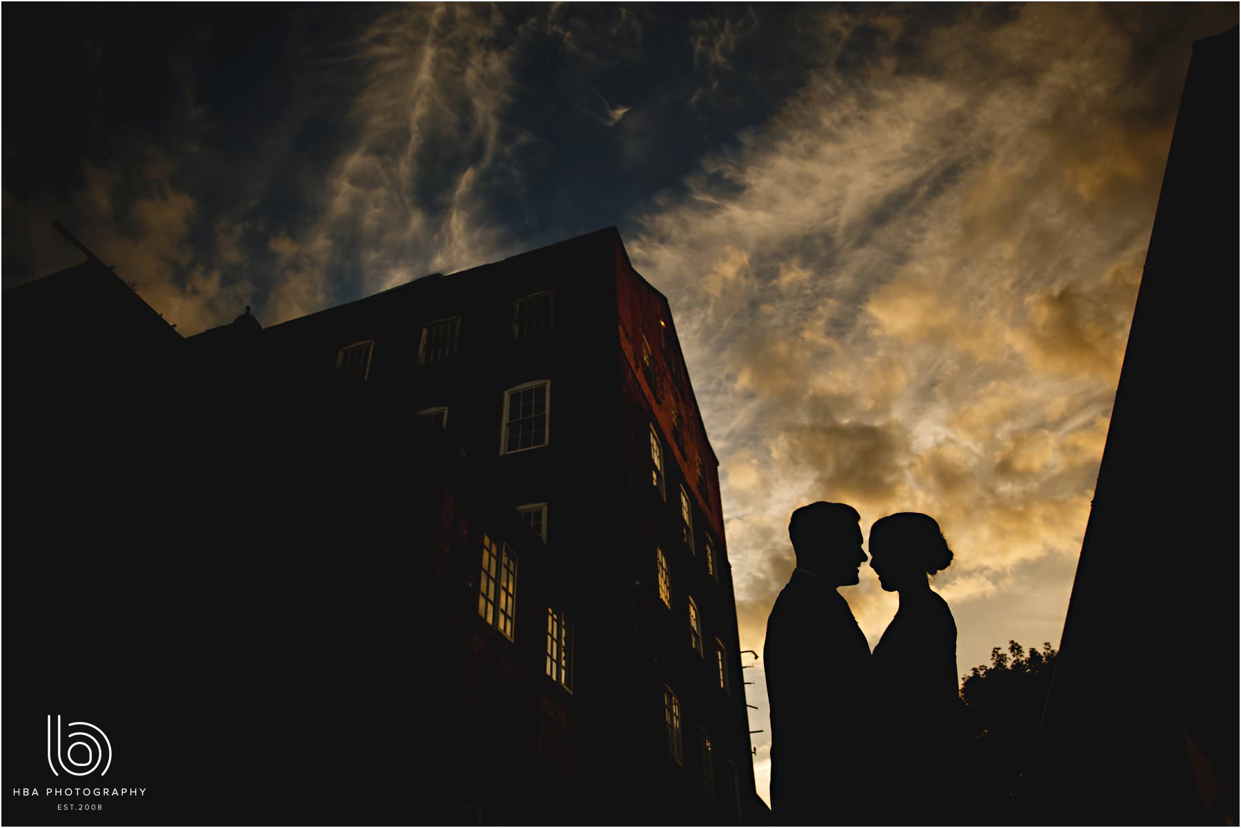 the bride & groom at night outside The west mill