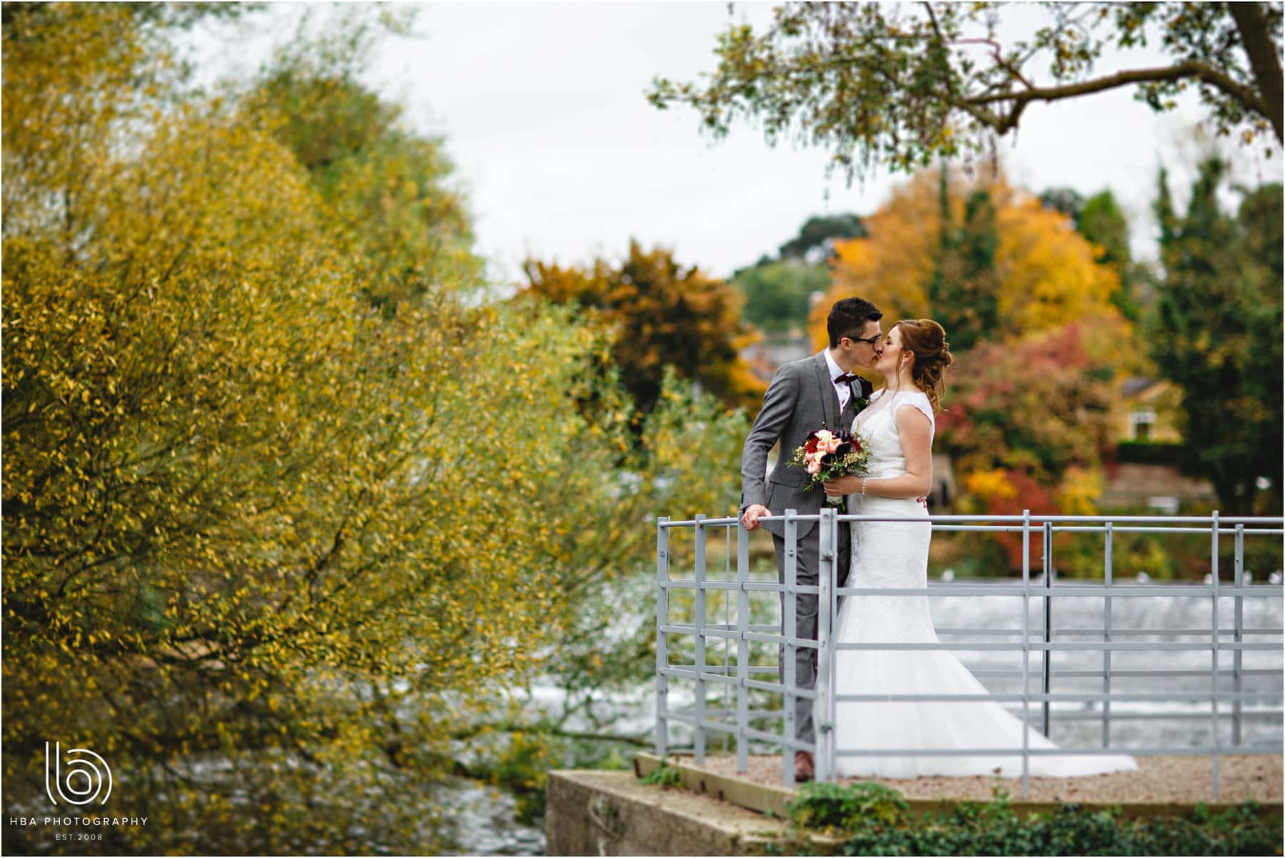 the bride and groom in the autumn colours