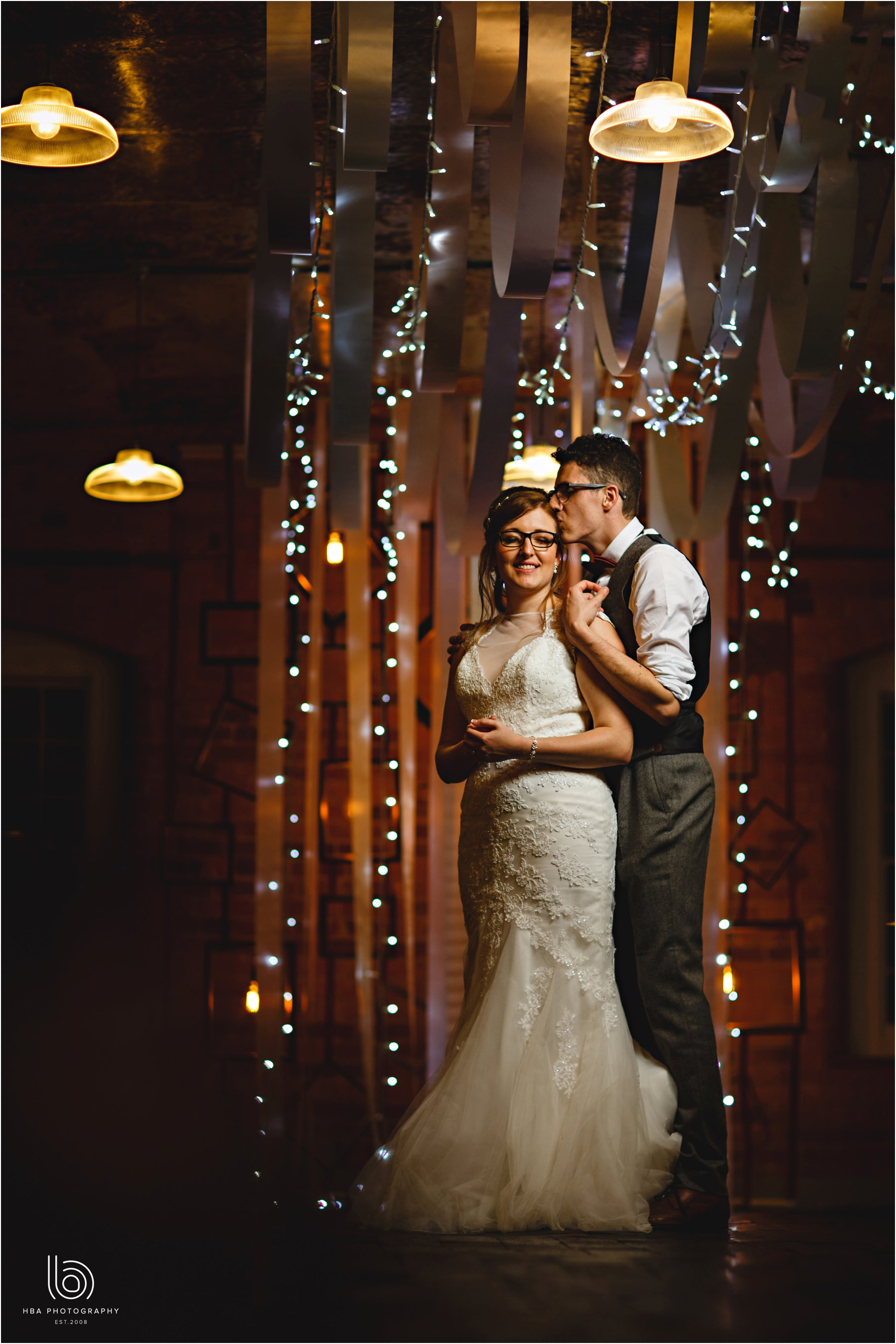 the bride and groom twinkly lights