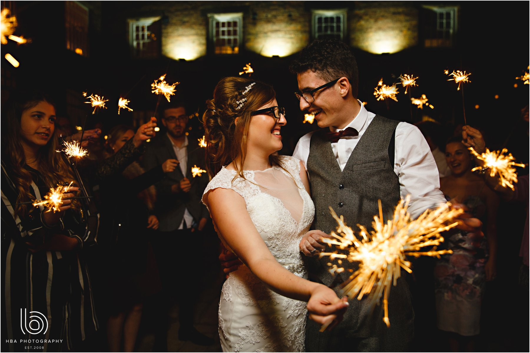 the bride and groom with sparklers