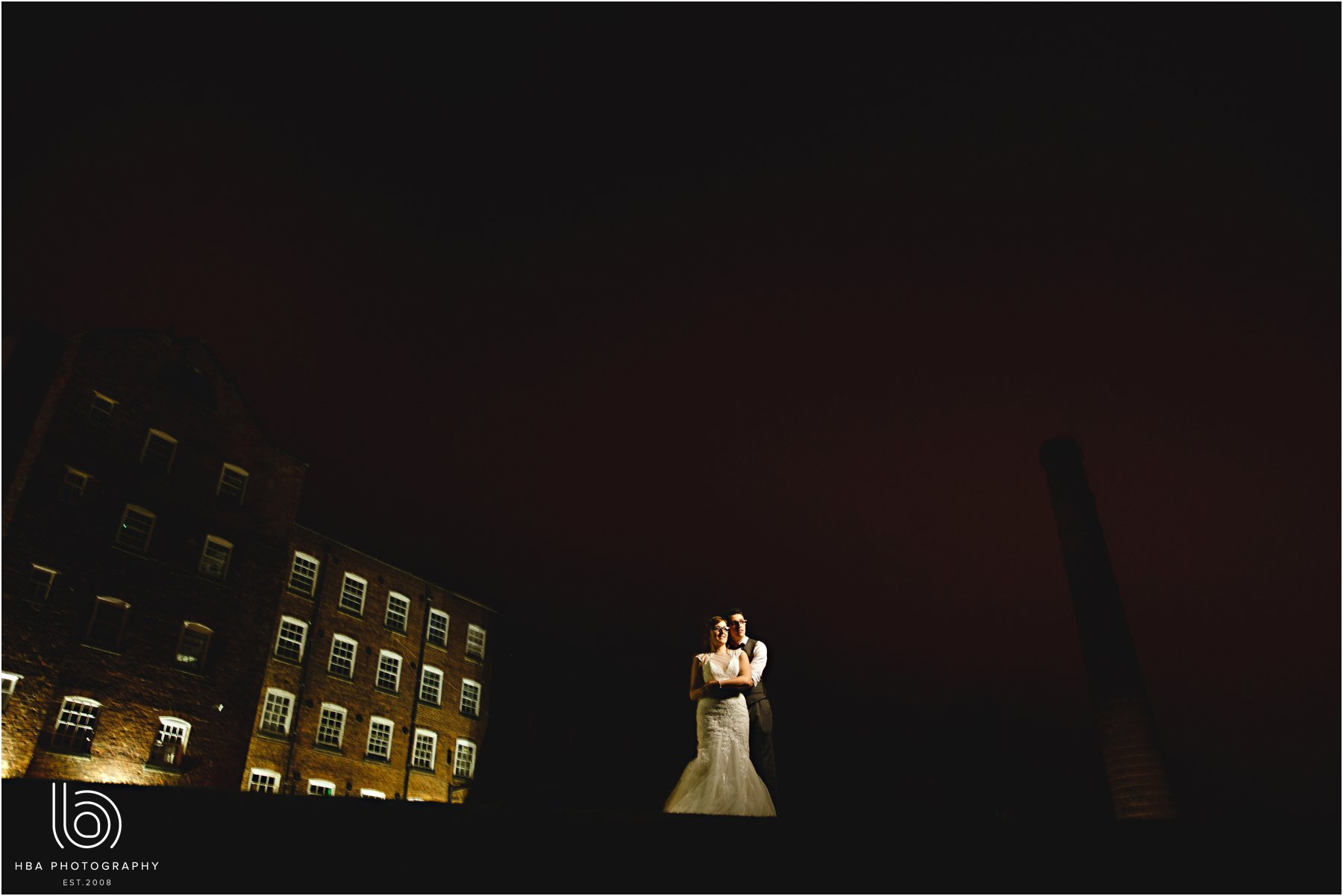 the bride and groom at night at the west mill