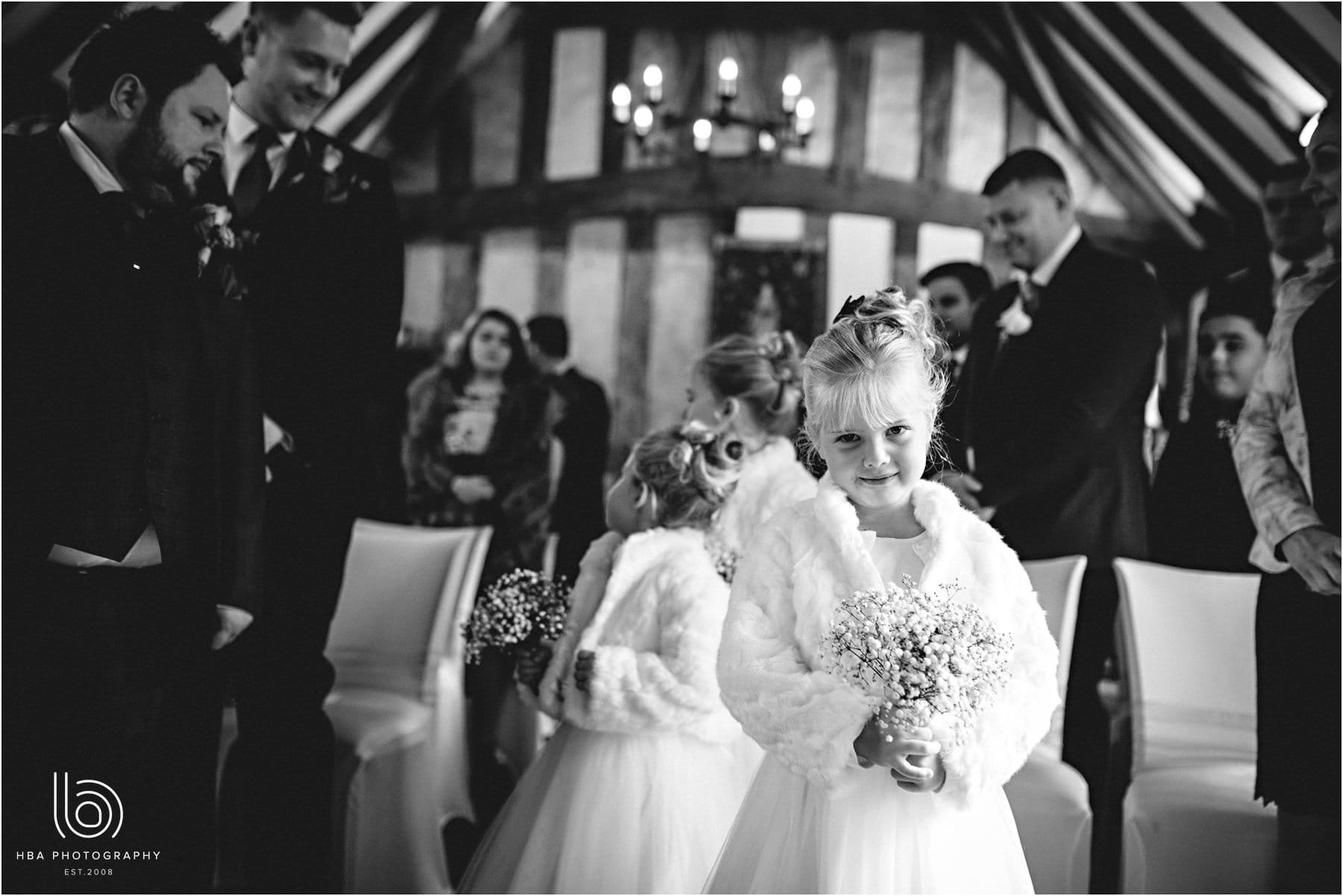 the flower girls coming down the aisle